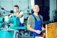 Two worker in factory Stock Images