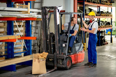 Two worker in factory Stock Photos