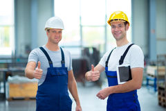 Two worker in factory with thumb up Stock Photos