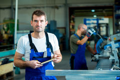 Two worker in factory Royalty Free Stock Images