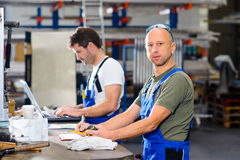 Two worker in factory Stock Image