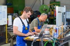 Two worker in factory Royalty Free Stock Photography