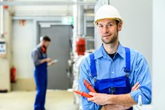 Two worker with helmet ,ear protector and goggles royalty free stock photos