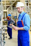Two worker with helmet ,ear protector and goggles royalty free stock photography