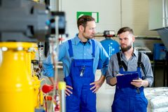 Two worker in industrial plant royalty free stock photography