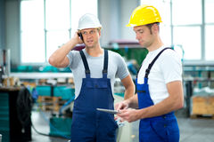 Two worker with phone and tablet PC royalty free stock image