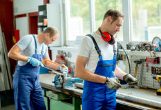 Two worker on work bench Royalty Free Stock Photo