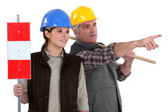 Two workers. With road signs Royalty Free Stock Photos