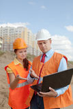 Two workers  on the building site Royalty Free Stock Photos