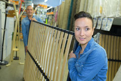 Two workers carrying bed frame in warehouse Royalty Free Stock Photo