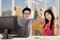 Two workers celebrating their achievement Stock Photo