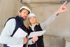 Two workers checking last details on a construction site Royalty Free Stock Images