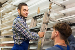Two workers choosing PVC window profile Royalty Free Stock Image