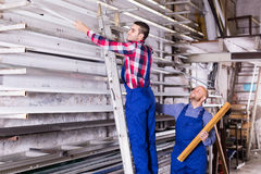 Two workers choosing PVC window profile Royalty Free Stock Photography