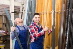 Two workers choosing PVC window profile Stock Photography