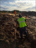 Two workers at construction site sunrise dirt field. Stock Image