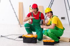 Two workers contractors working indoors. The two workers contractors working indoors royalty free stock photos