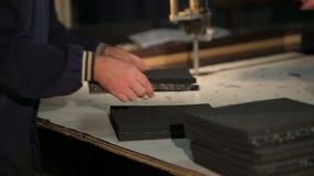 Two workers cut polyurethane foam stock footage