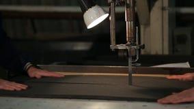 Two workers cut polyurethane foam stock video