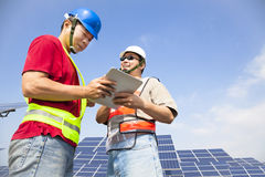 Two workers  discussing with tablet Stock Photography