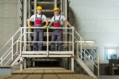 Two workers on a factory Stock Image