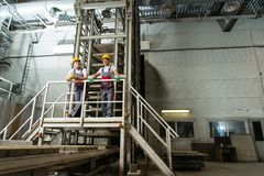 Two workers on a factory Stock Photography