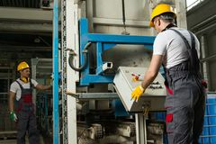 Two workers on a factory Stock Photos