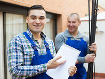 Two workers at factory Royalty Free Stock Images