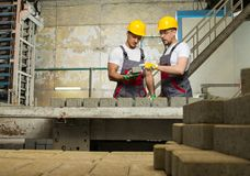 Two workers on a factory Royalty Free Stock Images