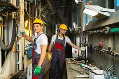 Two workers on a factory Royalty Free Stock Photos