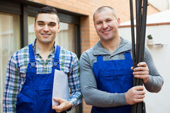 Two workers at factory Royalty Free Stock Photos