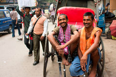 Two workers of hand-pulled rickshaw smile Royalty Free Stock Image