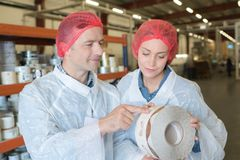 Two workers in industrial production Royalty Free Stock Photos