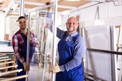 Two workers inspecting windows Stock Photos