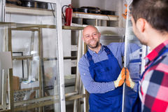 Two workers inspecting windows Stock Photo