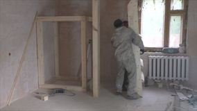 Two workers install wooden staircase. Carpentry stock footage