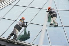 Two workers installing outside window Royalty Free Stock Photography