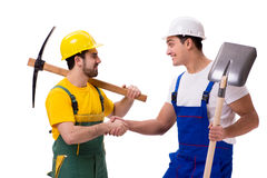 The two workers isolated on the white background. Two workers isolated on the white background Royalty Free Stock Photos