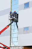 Two workers on the lift platform Royalty Free Stock Photo