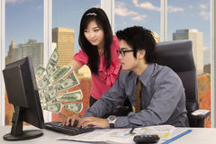Two workers look at money cash Stock Image
