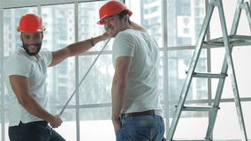 Two workers make repairs in a new apartment stock footage