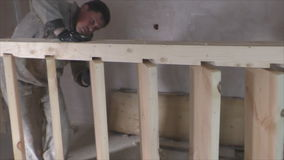 Two workers make wooden staircase. Carpentry stock video footage