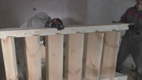 Two workers make wooden staircase. Carpentry stock footage