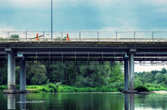 Two workers on modern bridge Stock Photos