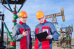 Two workers in the oilfield Royalty Free Stock Images