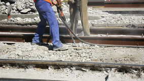 Two Workers with pneumatic hammer. Drill equipment breaking Concrete at construction site stock footage
