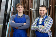 Two  workers posing in PVC shop Royalty Free Stock Photos