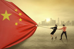 Two workers pulling a chinese flag Royalty Free Stock Images