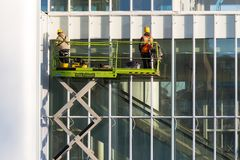 Two Workers repairing at a building. View of two Workers repairing at a building stock photography