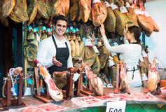 Two workers selling jamon Royalty Free Stock Image